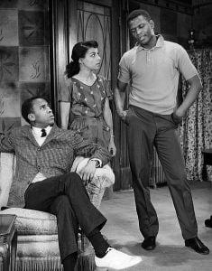 """Ruby Dee in 1959 with Sidney Poitier and Louis Gossett Jr. in """"A Raisin in the Sun."""" (Public Domain)"""
