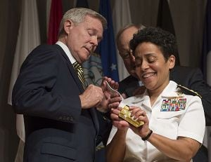 Michelle Howard is the first woman to be promoted to the rank of admiral in the history of the U.S. Navy. Secretary of the Navy Ray Mabus assists in placing four-star shoulder boards on her service white uniform. (Photo: Peter D. Lawlor/U.S. Navy)