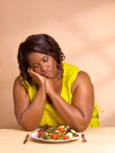 It's important to manager negative emotions when trying to lose weight or maintain a healthy weight. (Photo Credit: Peter Dazeley/Getty Images)