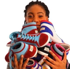 Little League star Mo'ne Davis with her new line of shoes, a portion of which will helps girls around the world. (Photo: M4D3 — Make A Difference Everyday)