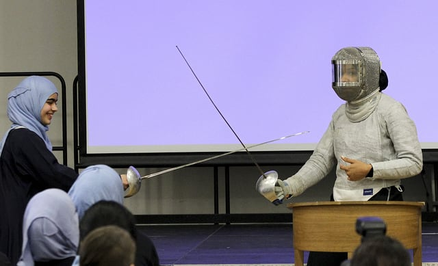 Fencer Ibtihaj Muhammad with a student at Sarah Bonnell School in Stratford East London in 2013. (Photo: Creative Commons)