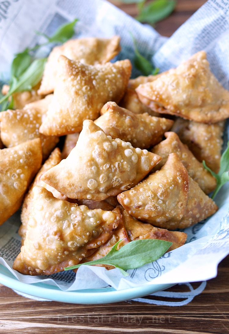Crunchy Samosas | These are not your usual samosas. Filled with rhubarb and sorrel that lend their tart flavor, along with the more traditional potatoes and peas, they are downright spectacular! #samosas #Indian #appetizer #rhubarb #sorrel