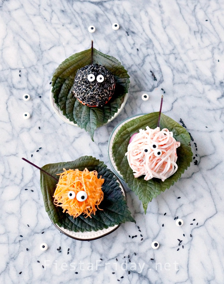 Halloween Monster Sushi Balls... yes, indeed! Move over pumpkins! These sushi balls are so easy and most importantly, fun to make. If you can squeeze rice into balls, you can make Halloween Sushi Balls! | FiestaFriday.net