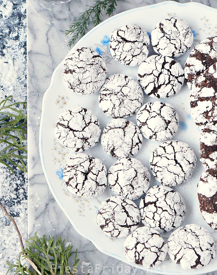Candy Cane Kiss Chocolate Crinkle Cookies may become your signature Christmas cookies, but before you make them, find out the secrets to making perfectly crackly cookies! #cookies #Christmas #chocolate #crinklecookies #candycane #hersheykiss