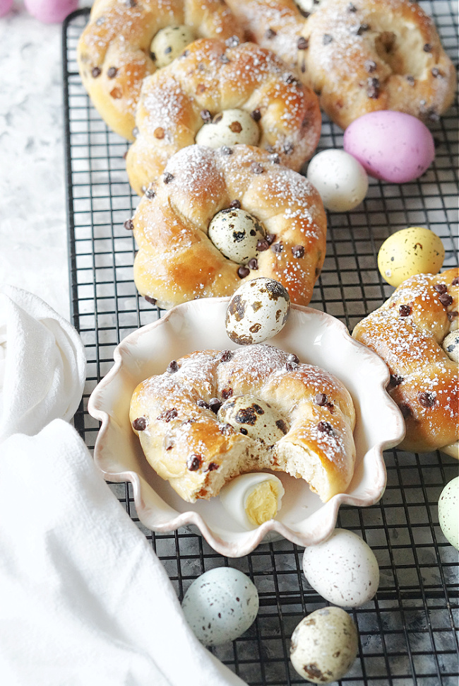 Easter Bread Wreaths with Quail Eggs are the diminutive relatives of Greek or Italian Easter Bread, and because they're made using the Tangzhong method, they're wonderfully fluffy and soft, even the next day! #easter #easterbread #wreathbread #italianeasterbread #eggs #quaileggs #chocolate #chocolatechips #tangzhong #tangzhongbread #vanilla #fiestafriday