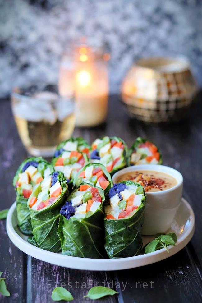 Gado Gado, an Indonesian cooked-vegetable salad, presented as rolls. Because, let's face it, it's much more fun eating food sans utensils. #appetizer #snack #healthy #vegetarian #vegan #gadogado #rolls #Indonesianfood #vegetables #peanut #peanutsauce #collardgreens #rainbowfood #stpatricksday