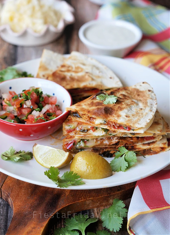 Killer Quesadilla is the name my family bestows on this Pineapple Margarita Chicken Quesadilla because it's so incredibly delicious #quesadilla #quesadillas #mexicanfood #cincodemayo #appetizer #chicken #pineapple #margarita #tequila #triplesec #limejuice