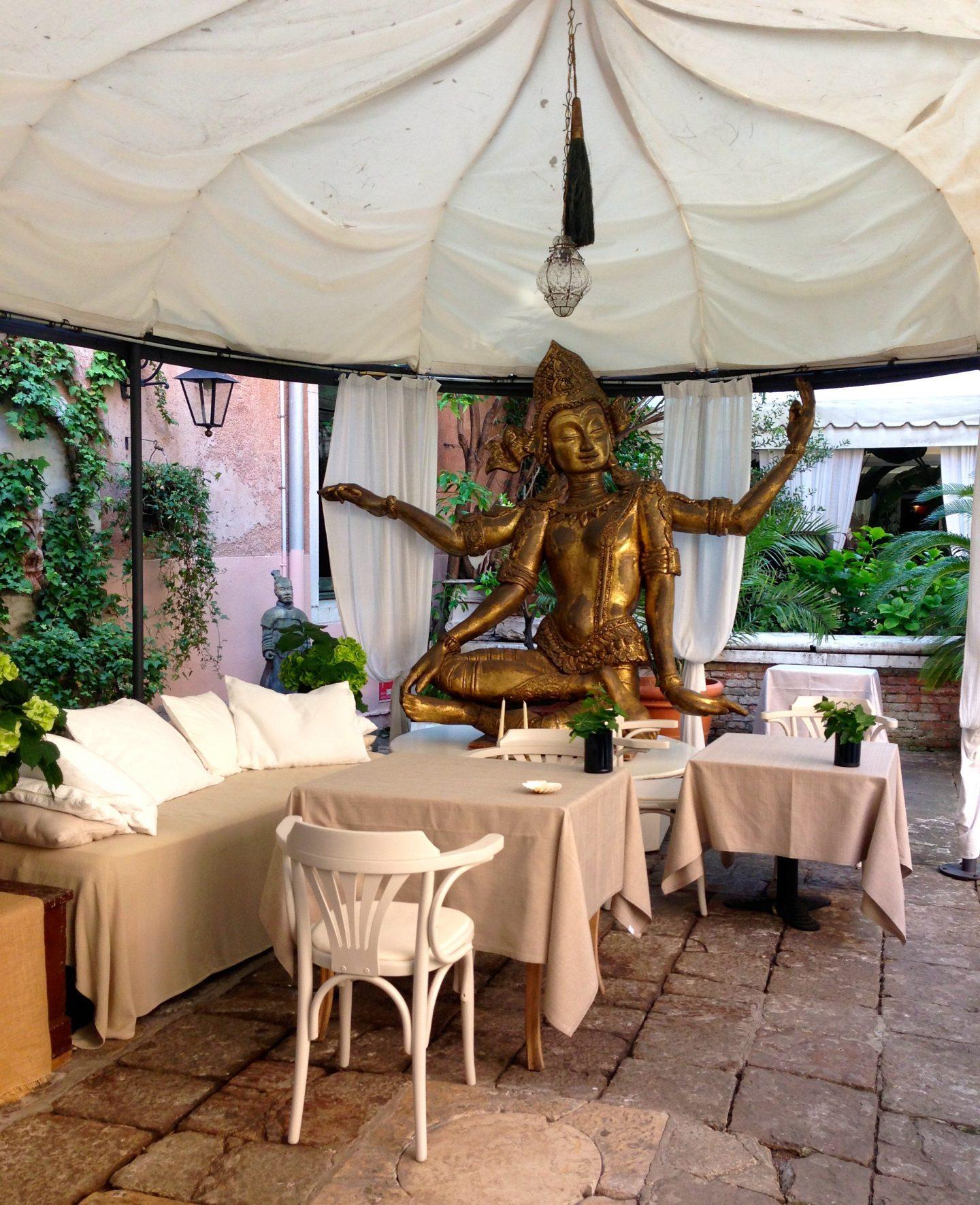 Eating breakfast in the courtyard of Hotel Metropole in Venice.
