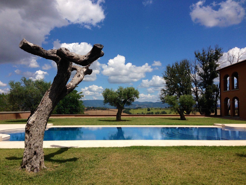 Chilling poolside at Villa Loggia winery in Cortona Tuscany.