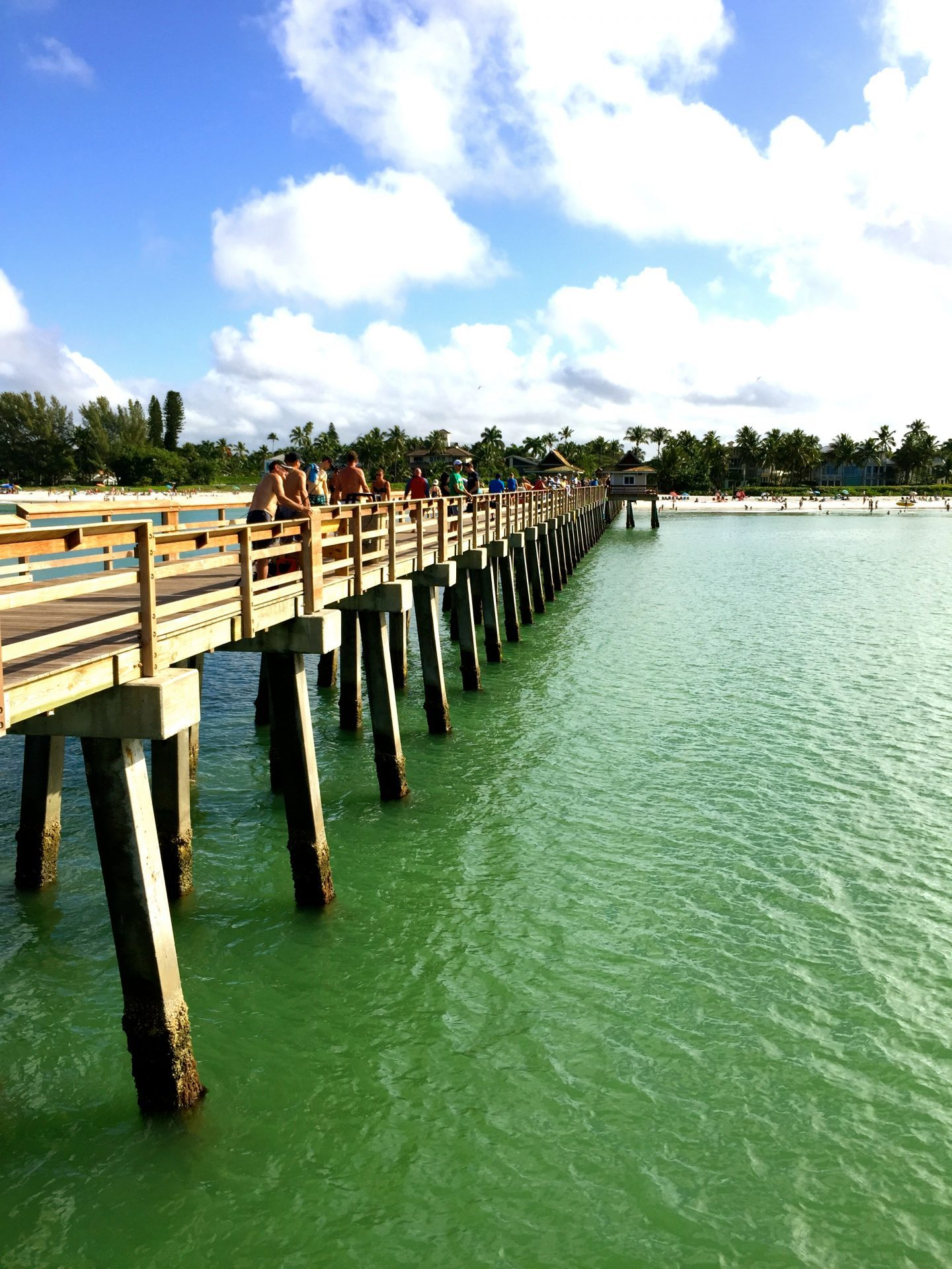 Aqua green water at the town pier in Naples Florida.