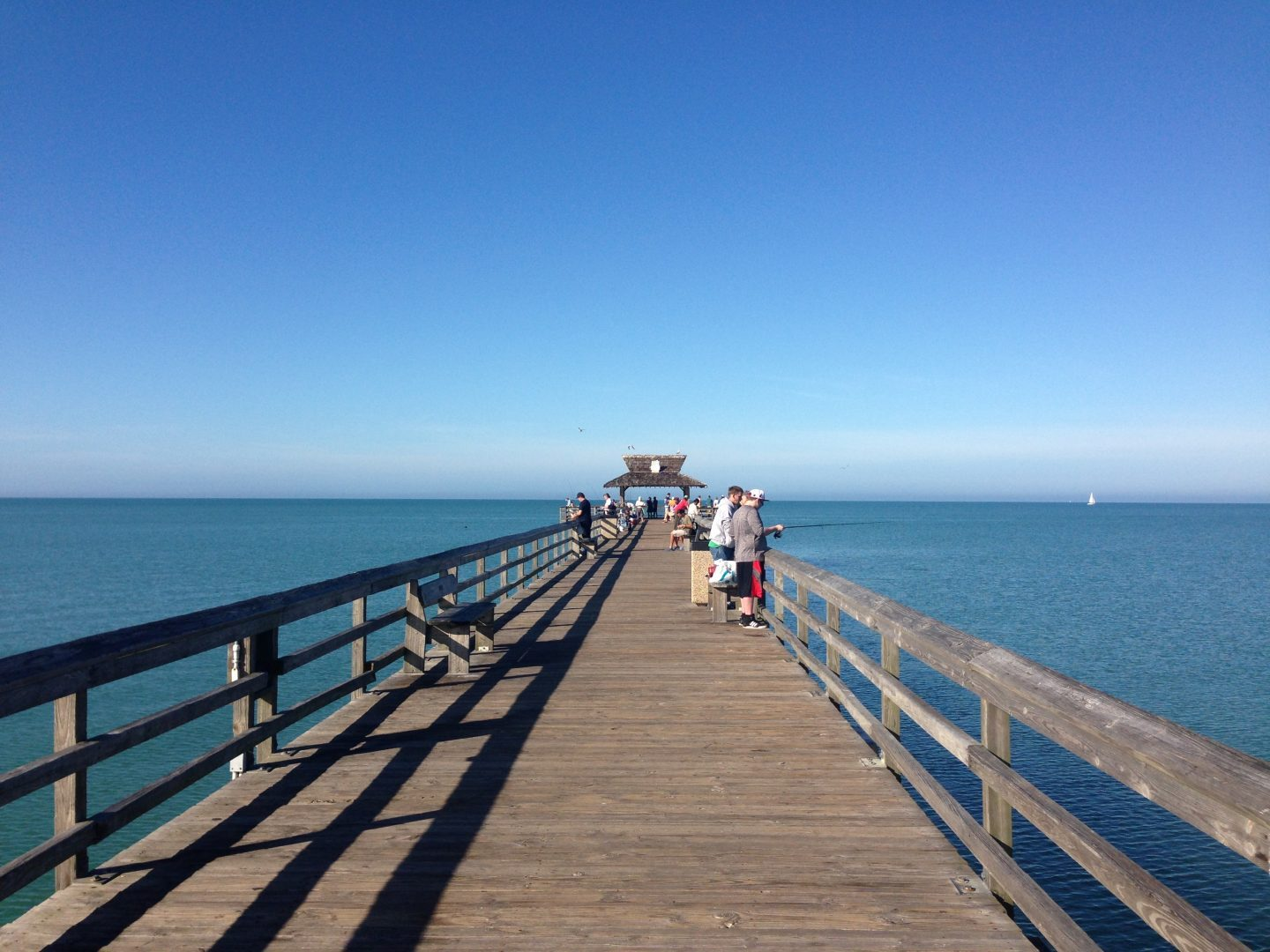 Walking on the town pier in Naples Florida.
