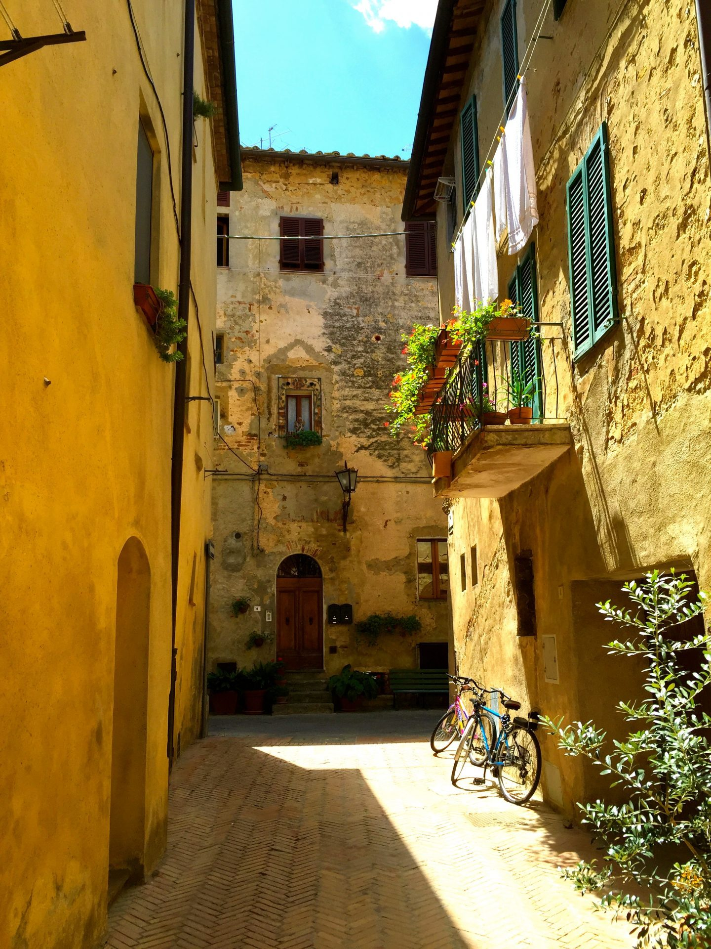 Walking down an alleyway in Pienza Tuscany.