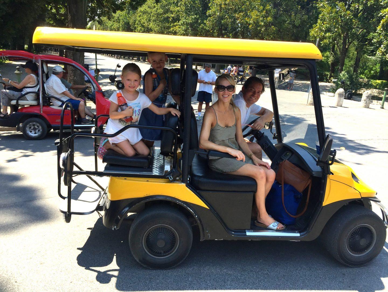 Cruising around Villa Borghese in Rome in golf carts.