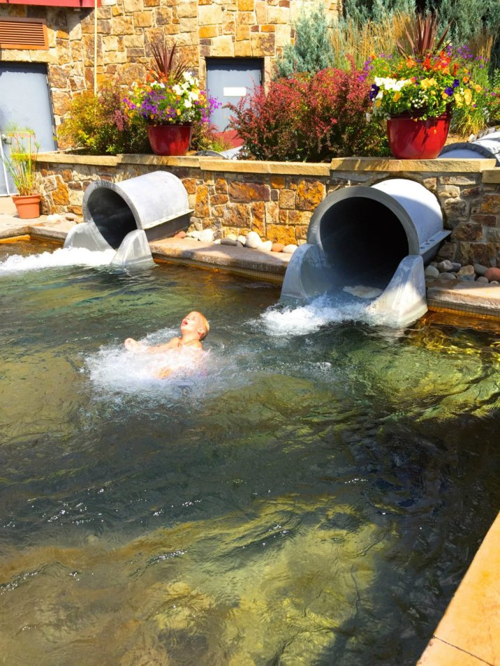 Coming out of the water slide at Old Town hot springs in Steamboat Springs, CO.