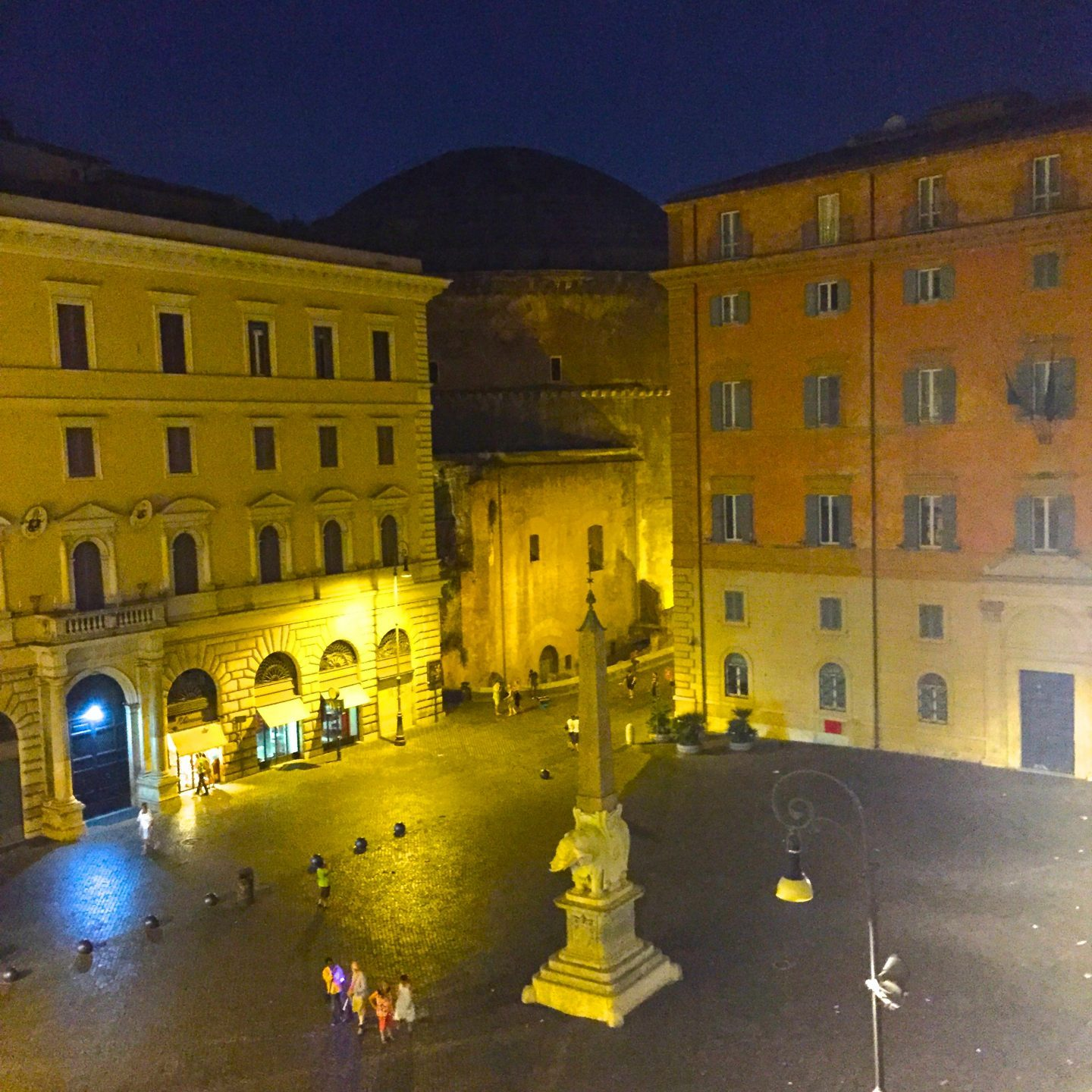 Playing in a Roman piazza at night.