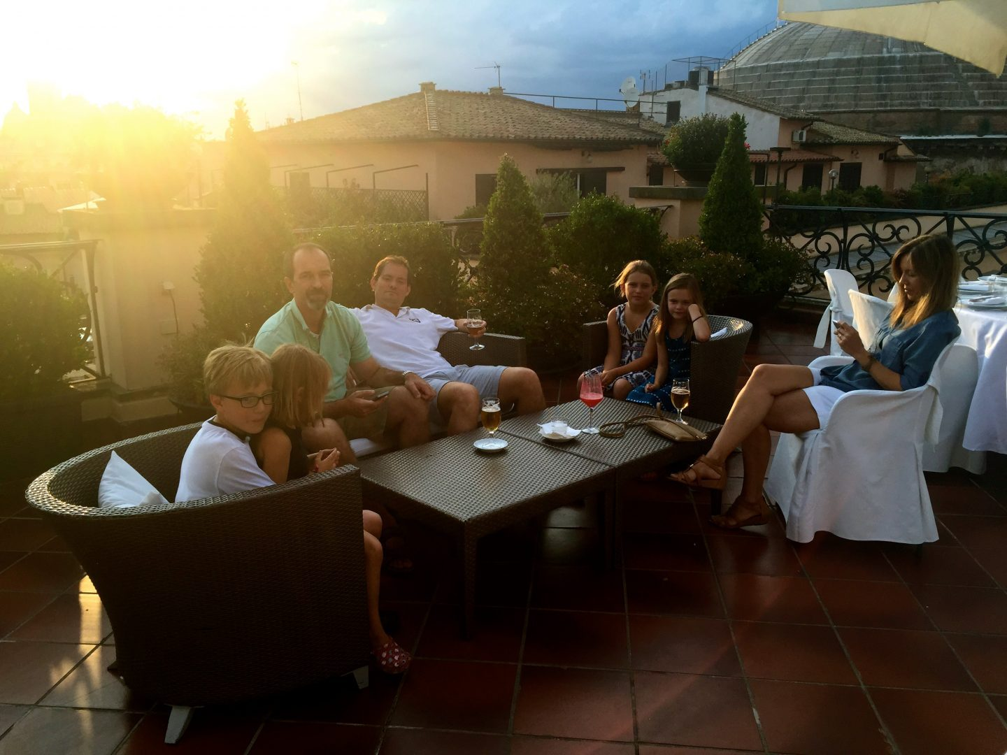 Sunset hour on a rooftop hotel in Rome.