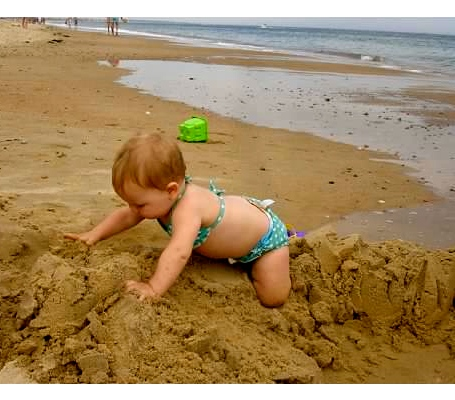 Playing in the sand at the beach in Watch Hill, RI.