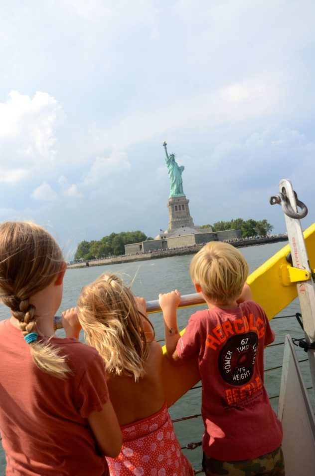 Kids looking at the Statue of Liberty from the New York Water Taxi.