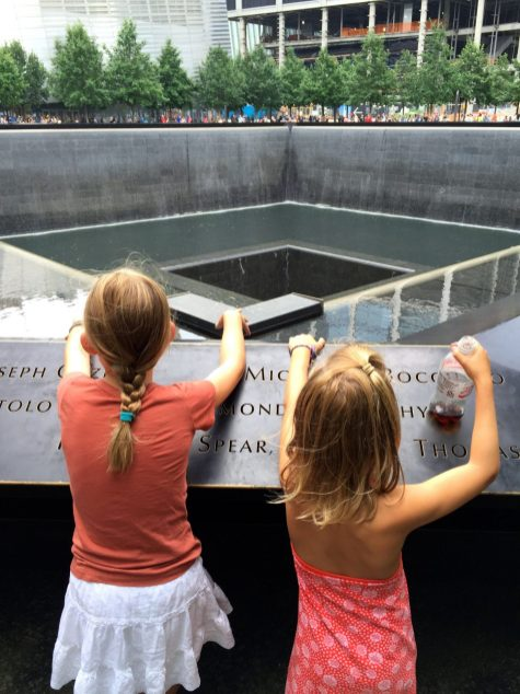 Kids looking into the pool and waterfall at One World Trade Center.