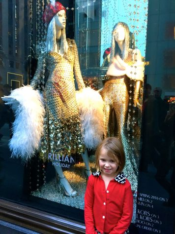 Viewing the Fifth Avenue store windows during Christmas in New York.