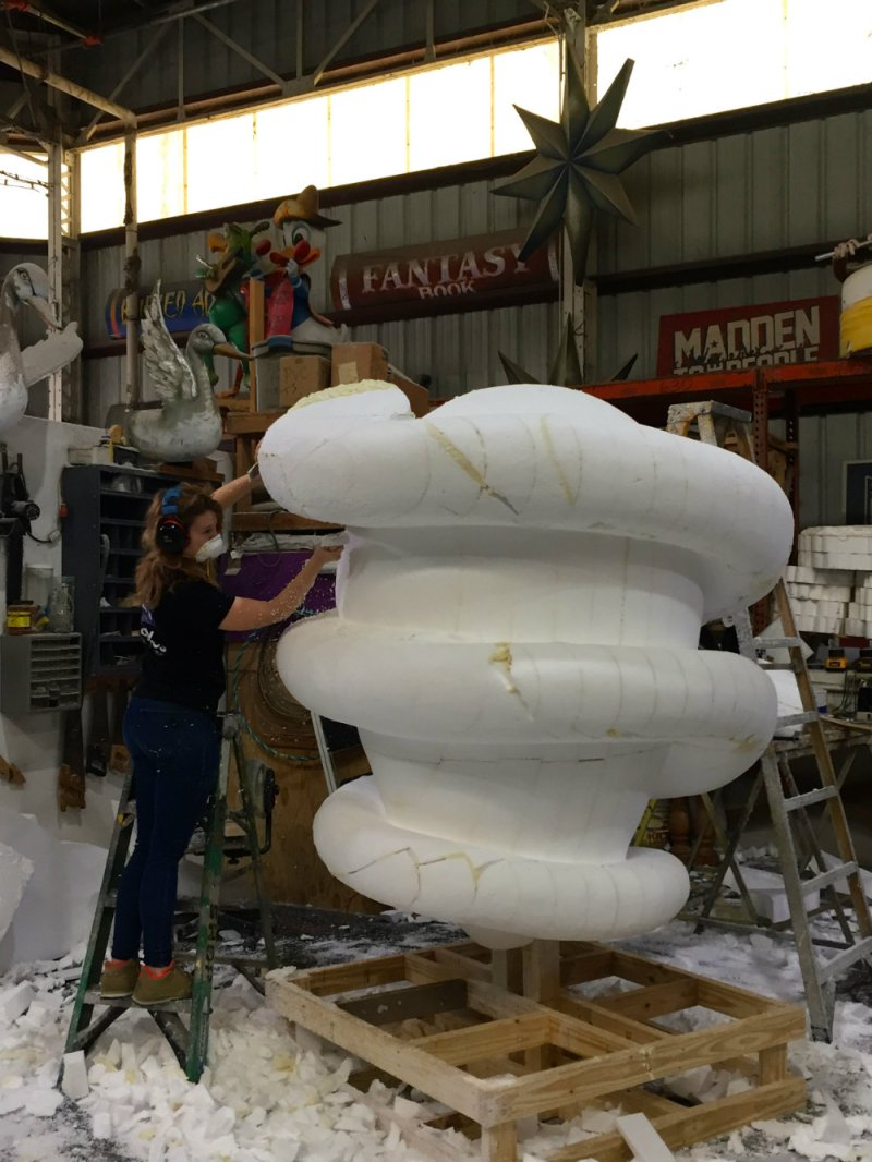 Artist working on a float at Mardi Gras World.