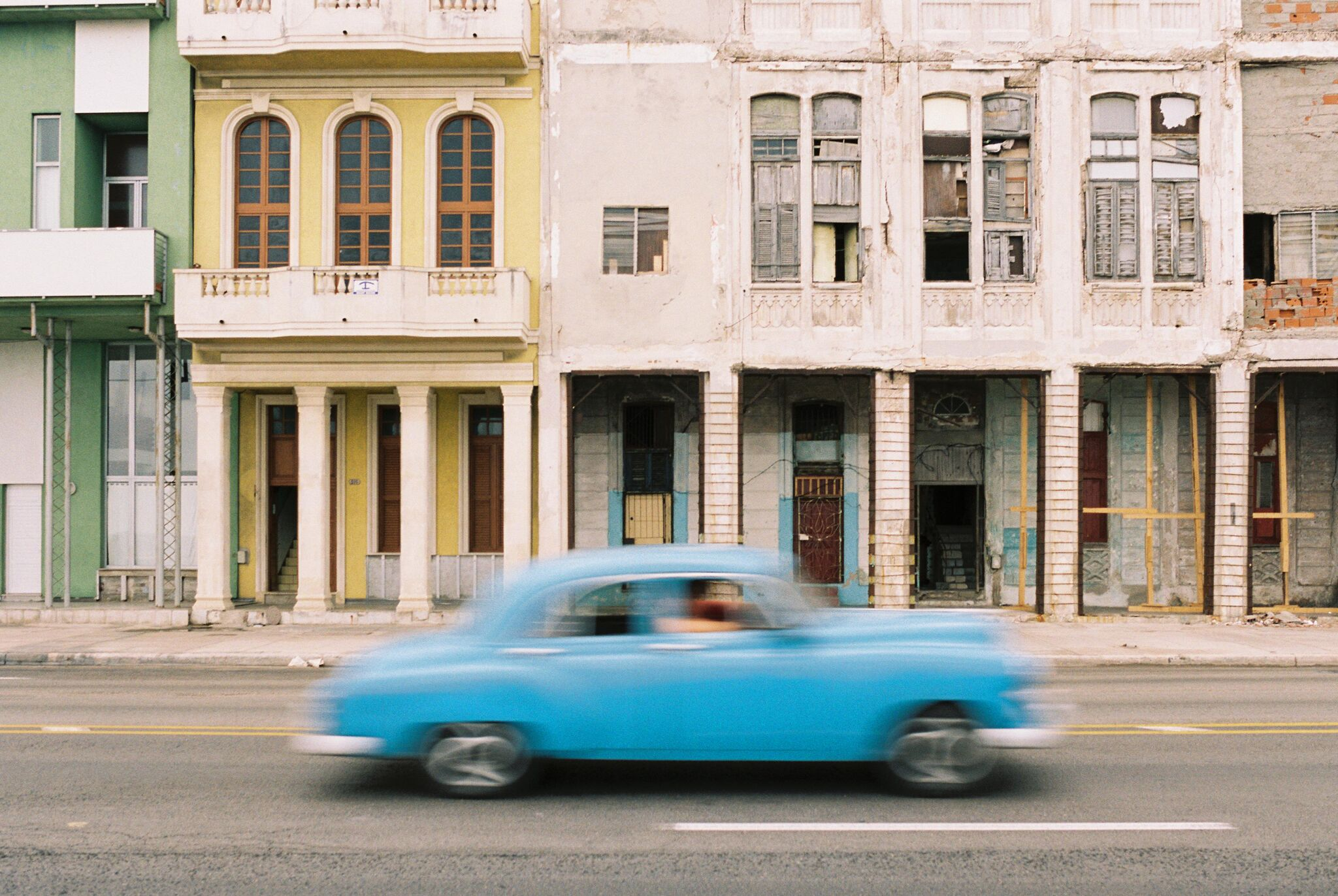 Car driving by in Cuba.