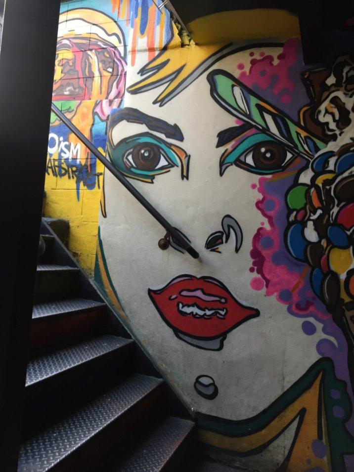 Black tap street scenes in Soho in New York City