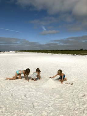 Making sandcastles on Keewaydin Island in Florida.