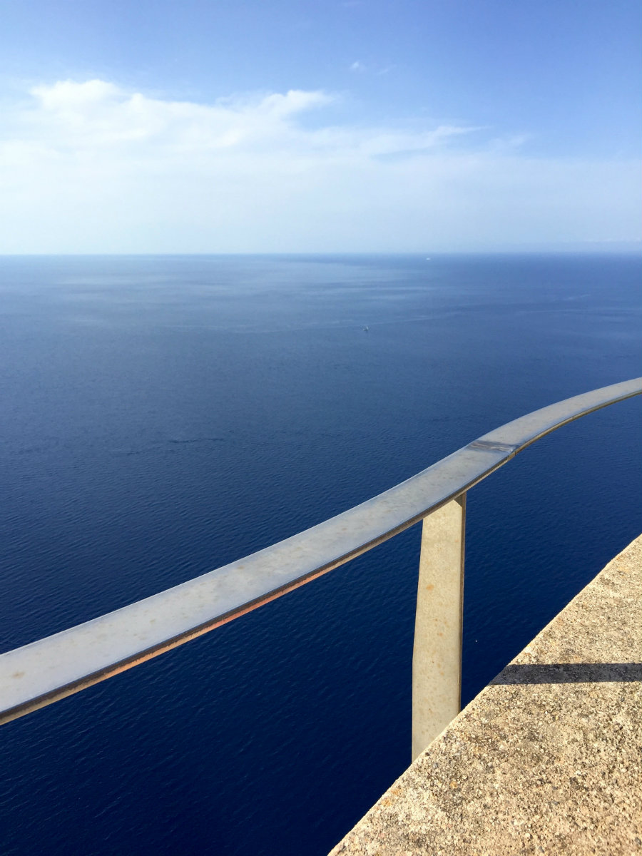 Looking out over the Mediterranean sea at the lighthouse on cap de Formentor
