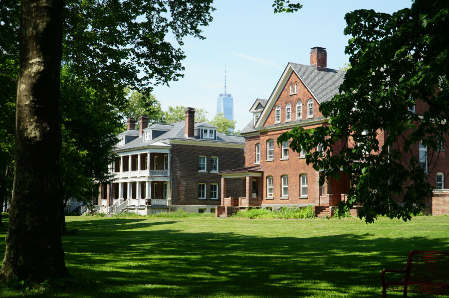 Historical buildings against the backdrop of the Manhattan skyline on Governors Island in New York