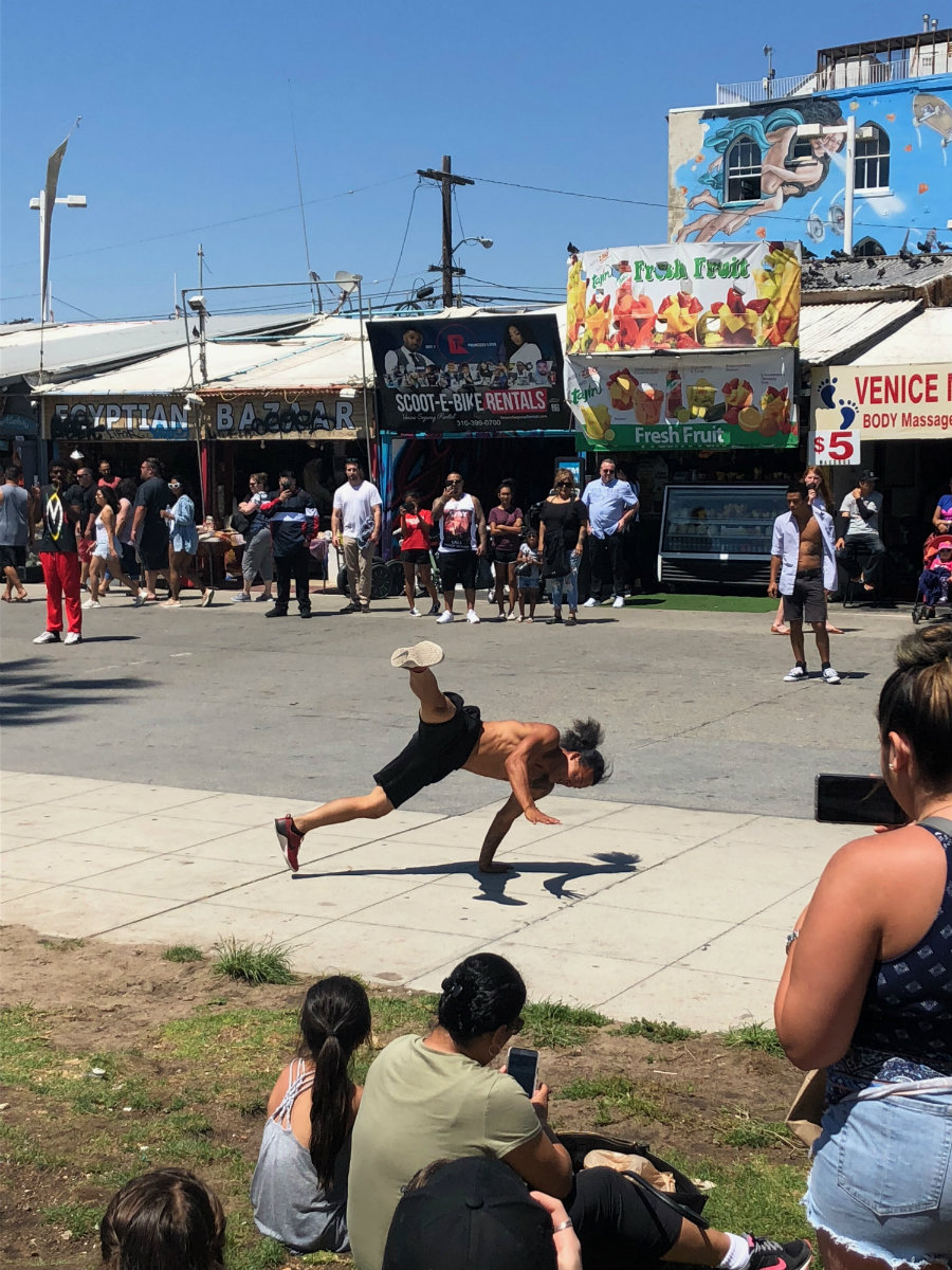 Watching the street performers and dancers on Venice Beach