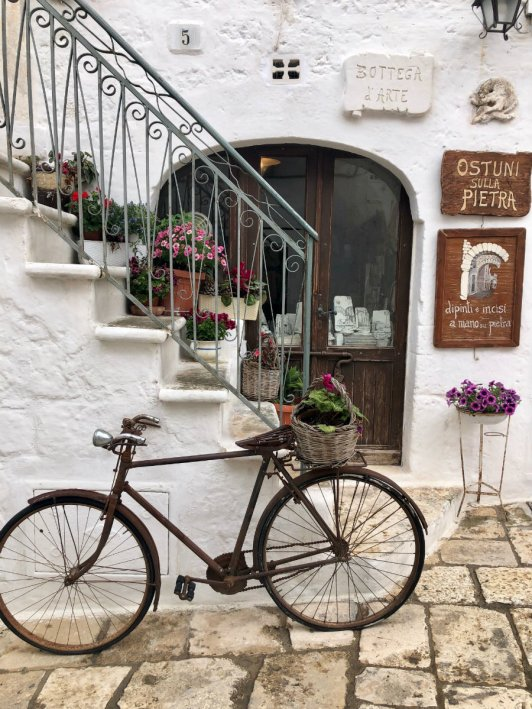 Perfect restaurants entryway with the bike in front in Ostuni Italy