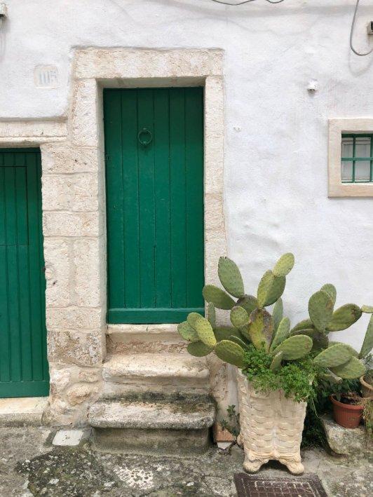 Green door in Ostuni Puglia Italy