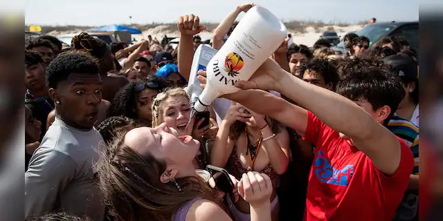 People gather for spring break on the beach in Port Aransas, Texas on, Friday, March 12, 2021.