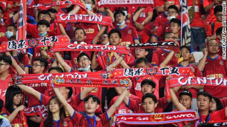 Fans cheer during the Guangzhou derby, the opening match of the new Chinese Super League season, on April 20 in Guangzhou, China.
