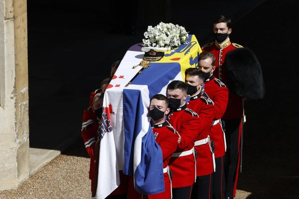 The bearer Party found by The Queen's Company, 1st Battalion Grenadier Guards, carry the coffin of Prince Philip to the