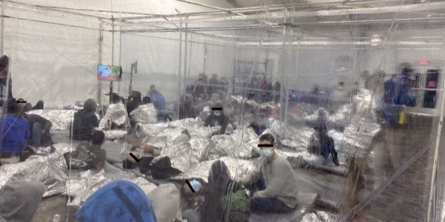 Migrants at a holding facility near the U.S. Southern border being kept in clear enclosures akin to cages. (Office of Rep. Henry Cuellar, D-Texas)