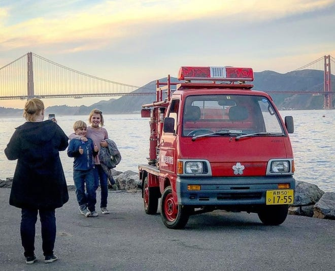 Two San Francisco landmarks, The Golden Gate Bridge and Kiri, make for a great photo op.