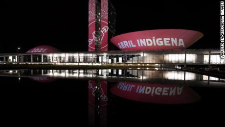 """Members of the Articulation of Indigenous Peoples of Brazil (APIB), project the phrase """"Indigenous April"""" at the National Congress in Brasilia during Indigenous Day, on April 19, 2021."""