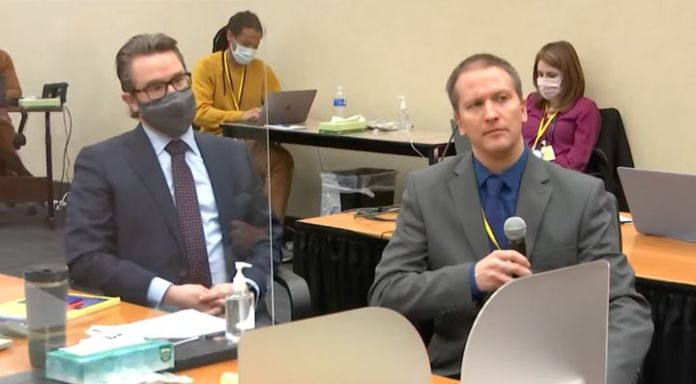 Defense attorney Eric Nelson (left) looks on as Derek Chauvin (right) tells Judge Peter Cahill on April 15 that he is invokin