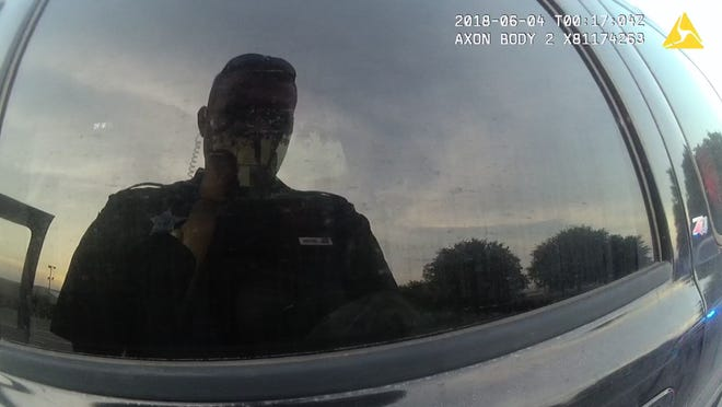 Former Jackson County, Florida, Deputy Zachary Wester's reflection seen on his body camera footage.