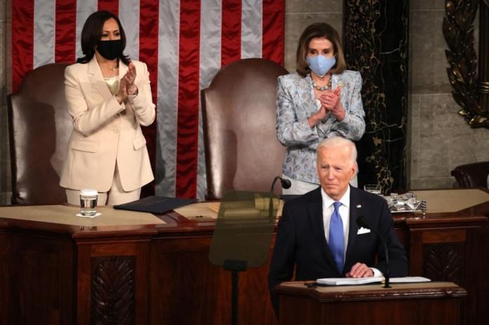 President Joe Biden addresses a joint session of congress as Vice President Kamala Harris (L) and Speaker of the House U.S. Rep. Nancy Pelosi (R) look on in the House chamber of the U.S. Capitol on April 28.