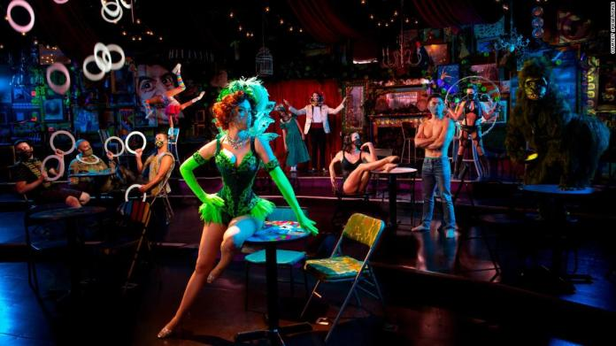 """""""Absinthe"""" is performed in a tent with guests seated at socially distanced tables."""