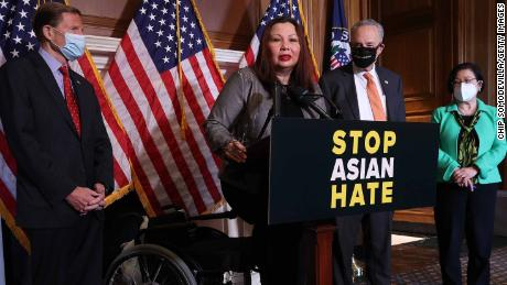 Democrat Sen. Tammy Duckworth, center, speaks during a news conference following the passage of the Covid-19 Hate Crimes Act at the US Capitol on Thursday.