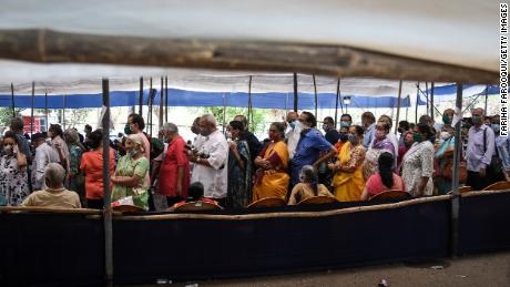 People line up to receive Covid-19 vaccines at a mass vaccination center on April 29 in Mumbai, India.