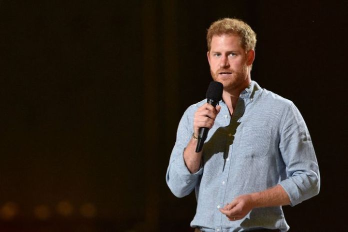 "Prince Harry speaks onstage during Global Citizen ""Vax Live: The Concert to Reunite the World"" at SoFi Stadium in Inglewood,"