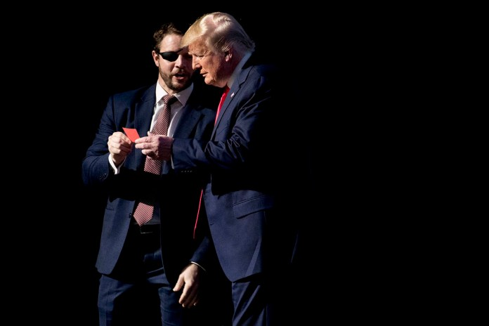Rep. Dan Crenshaw, R-Texas, with President Donald Trump