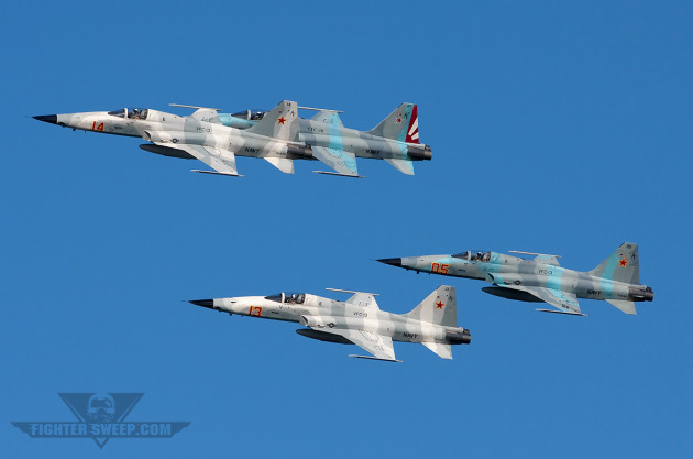 A four-ship formation of Bandits from VFC-13 over San Diego Bay.