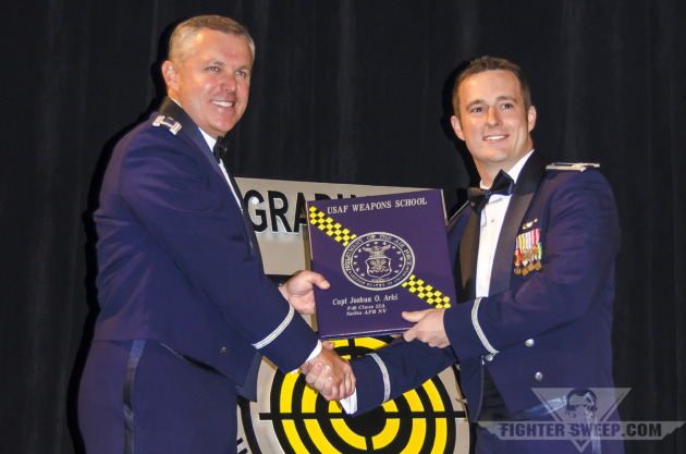 "Captain Joshua ""CATA"" Arki receives his diploma from the United States Air Force Weapons School"
