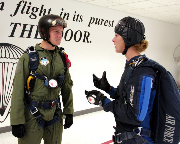 U.S. Air Force Academy Cadet 3rd Class David Barron is briefed by jumpmaster Cadet 1st Class Lindsey Robinson July 7 during Airmanship 490, Basic Parachuting, an airmanship program where cadets earn their basic jump wings after successfully completing five free-fall jumps. (U.S. Air Force photo/Mike Kaplan)